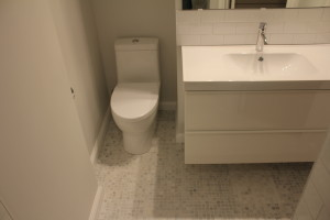 Small Carrera marble tile on bathroom floor